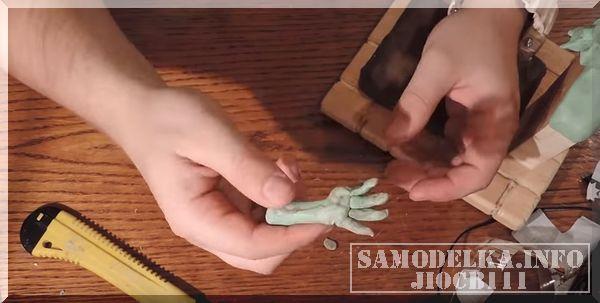 рука из полимерной глины